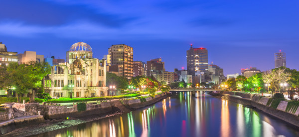 Hiroshima, Japan skyline and Atomic Dome at twilight on the river.