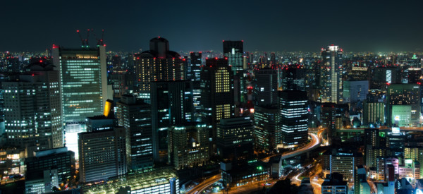 Panorama skyline of Osaka City in Japan at night with lots of lights