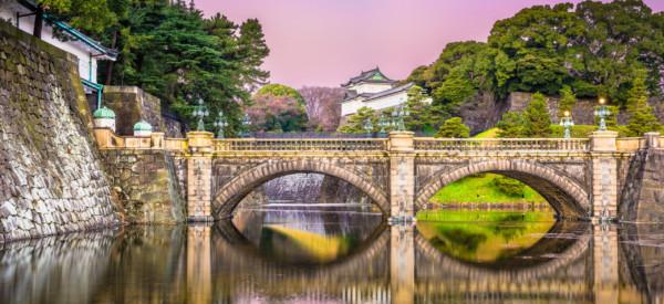 Tokyo, Japan at the Imperial Palace moat and bridge at dawn.