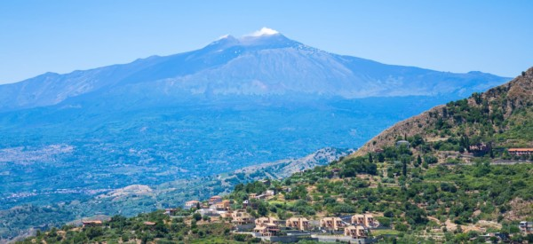 travel to Italy - view of villages and Etna volcano in Sicily