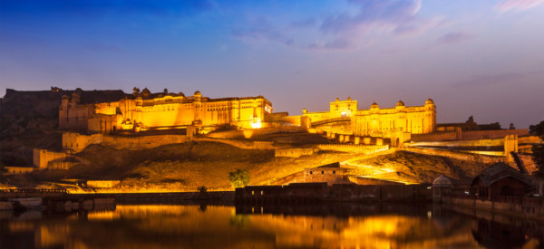 Amer Fort Amber Fort illuminated at night - one of principal attractions in Jaipur, Rajastan, India refelcting in Maota lake in twilight