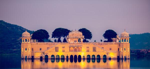 Vintage retro hipster style travel image of Rajasthan landmark - Jal Mahal (Water Palace) on Man Sagar Lake in the evening in twilight. Jaipur, Rajasthan, India